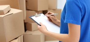 moving worker checking all essential for unpacking service