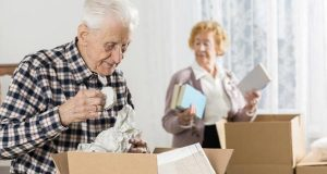 Old people packing small items