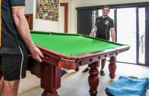 moving pool table by two men